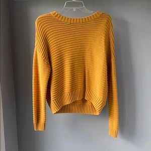 Front cropped yellow knit sweater